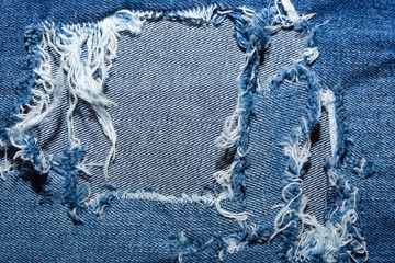 Blue Jean texture with a hole and threads