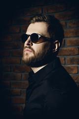 bearded man in sunglasses