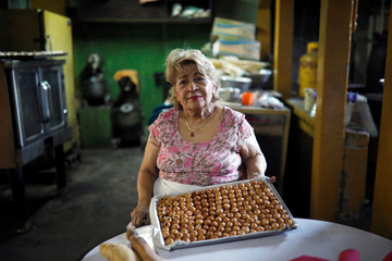 Julia Moran de Abrego, co-owner of Dulces Albanes candy store, poses for a picture as she prepares marzipan sweets for sale in Santa Tecla, El Salvador