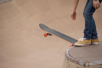 Skateboarder sakteboarding on skatepark ramp