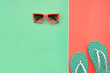 Modern fashionable sunglasses and sandals for background
