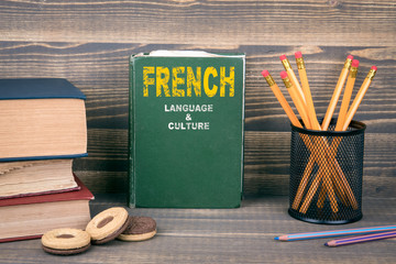French language and culture concept. Book on a wooden background