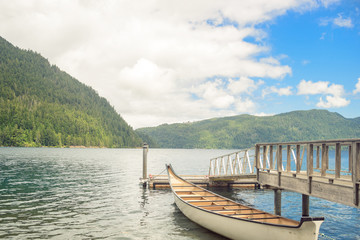 Wooden boat pier on mountain lake