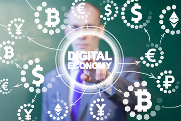 Digital Economy. Banking. Fintech. Trade Market Financial Technology. Man clicks on a digital economy words surrounded by currency icons.