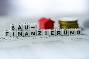 German Word Construction Financing formed by alphabet blocks: BAUFINANZIERUNG