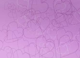 Herzen in lila und weiß vor lila Hintergrund