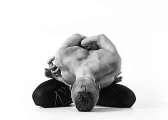 Yoga concept. Experienced yoga instructor performs various yoga poses on white isolated background. Black and white photo