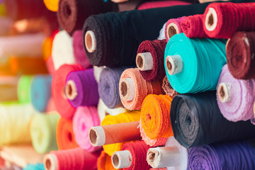 Fotobehang Stof colorsful fabric silk rolls in textile shop industry from india
