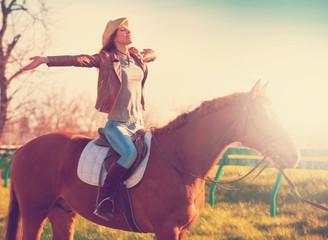 Woman sitting  horse. Sunset.