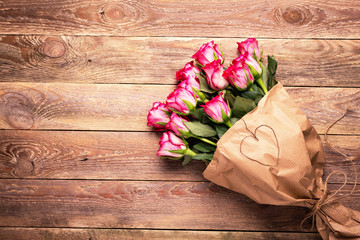Mothers Day - Bouquet of red roses on wooden background