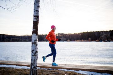 Picture of young athlete blonde at morning exercises in winter