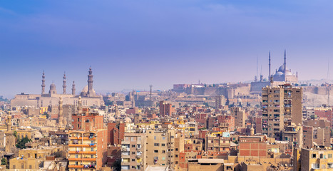 Aerial cityscape view of old Cairo, Egypt with Cairo Citadel and Sultan Hasan Mosque in far distance
