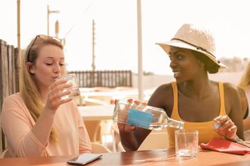 Thirsty girls drinking water