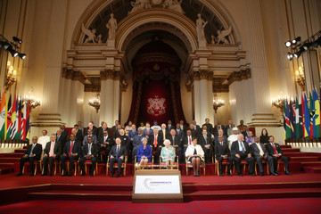 Commonwealth leaders pose for a family photograph with Britain's Queen Elizabeth during the formal opening of the Commonwealth Heads of Government Meeting in the ballroom at Buckingham Palace in London