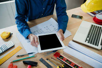 Businessman working with tablet.