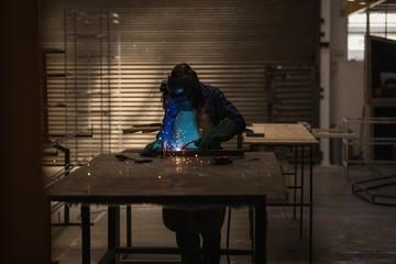 Female welder using welding torch