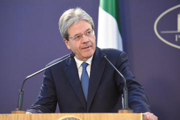 Italy's Prime Minister Paolo Gentiloni delivers a speech during a joint news conference alongside his Romanian counterpart Viorica Dancila in Bucharest