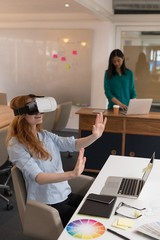 Female graphic designer using virtual reality headset