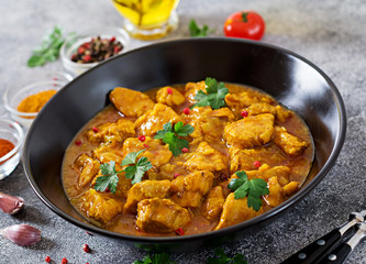 Curry with chicken and onions. Indian food. Asian cuisine.