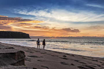 Couple walking on the beach of Cabo Ledo. Angola. Africa.