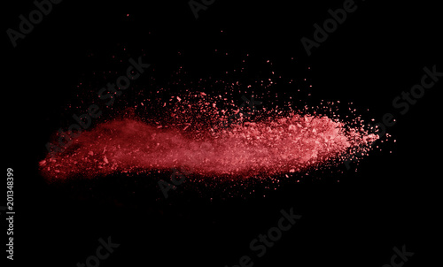Fototapete Abstract colored red powder explosion isolated on black background.