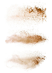 Fototapete - Abstract colored brown powder explosion isolated on white background.