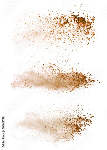 Fototapete Abstract colored brown powder explosion isolated on white background.