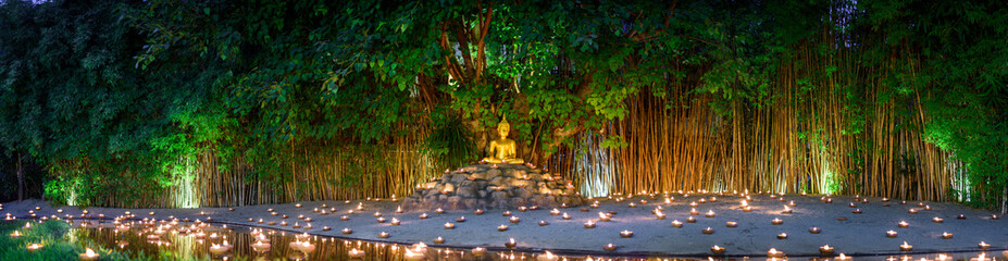 Poster Buddha monks sitting meditate with many candle in Thai temple at night , Chiangmai ,Thailand,