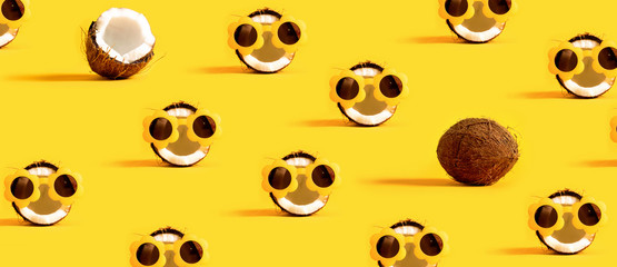 Series of coconuts wearing sunglasses on a yellow background