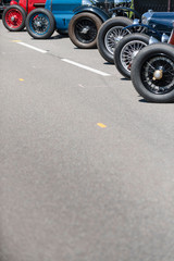 classic cars waiting at the pit for their great race with space for your text