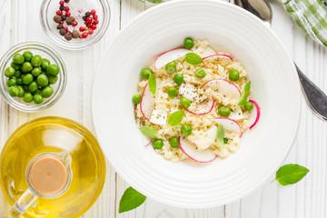Salad with couscous, green peas, mozzarella and radish