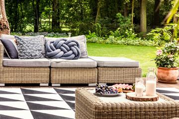 Rattan sofa in the garden