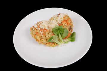 Risotto with carrot and cheese on black