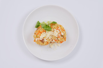 Risotto with carrot and cheese on white