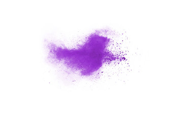Purple powder explosion on white background. Colored cloud. Colorful dust explode. Paint Holi.