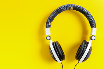 Jeans jacket headphone on yellow background, isolated