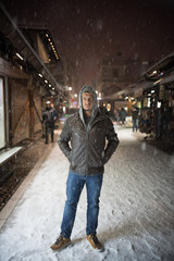 Portrait of a man standing in a city street in the snow