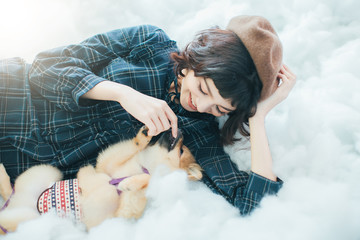 Beautiful women playing with dog in the room happy.