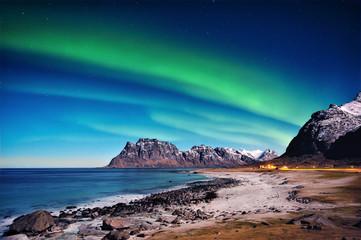 Northern lights over beach, Utakleiv, Nordland, Lofoten, Norway