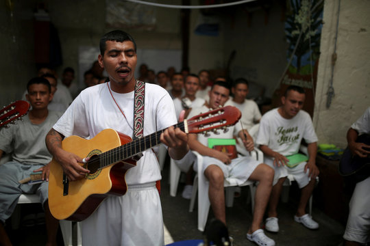 The Wider Image: Wolves to lambs: finding God behind bars in El Salvador