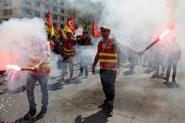 French state-owned railway company SNCF employees and CGT labour union members attend a demonstration against the French government's reform plans in Lyon