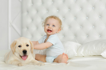Baby girl with labrador puppy