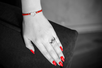 Bracelet red thread with a silver heart and red nails