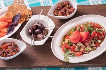 Набор закусок из овощей, красной рыбы и оливок, Set of snack from vegetables, red fish and olives