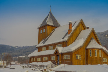 Aluminium Prints Monument Outdoor view of the Stave Church partial covered with snow during a heavy winter season in Gol