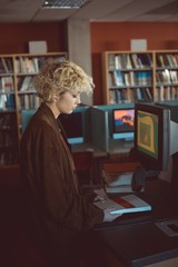 Woman holding a book in library