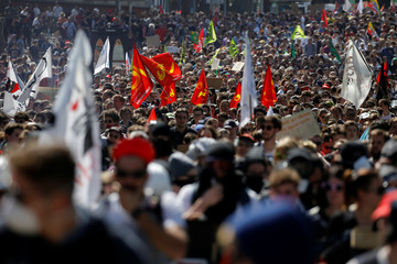 People attend a demonstration against the French government's reform plans as part of a national day of protest, in Nantes