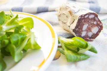 salami smoked sausage near lettuce salade