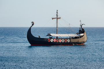 old black ship in the open sea