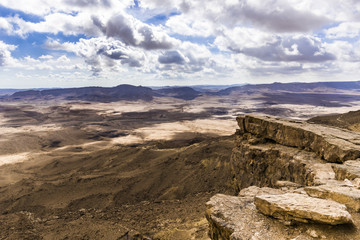 Clouds over a rocky plateau in the Negev desert